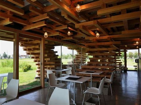 cafe design and build modern cafe with unique stacked wood support cafe kureon