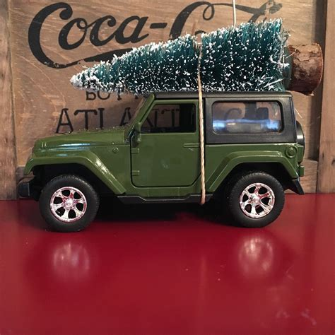 jeep ornament green jeep wrangler carrying tree ornament by