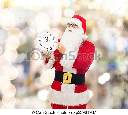 stock photos of man in costume of santa claus with clock