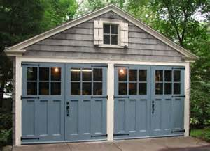 garage style hinged swing out carriage doors made by evergreen carriage