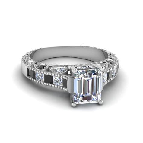 emerald cut antique channel set shank engagement ring
