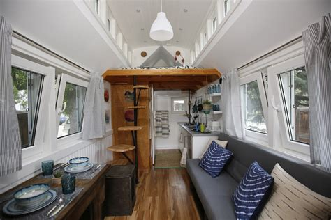 inside tiny hosues inside a handsome tiny house with solar shingles curbed