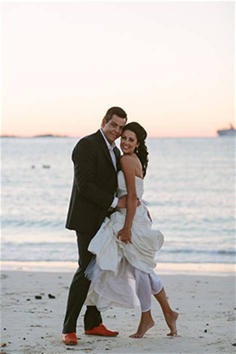 a brightly colored beach wedding in the bahamas the