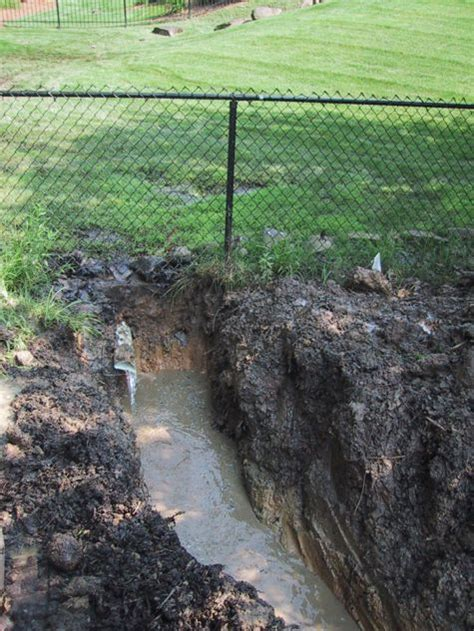 french drain backyard groundwater discharge from neighboring property water