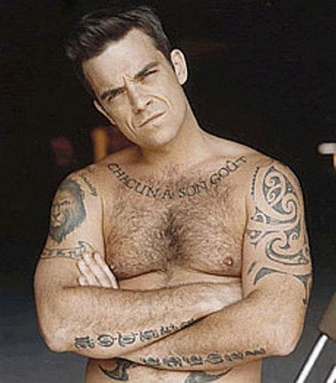 cristiano ronaldo tattoos robbie williams claims cristiano ronaldo isn t driven by money