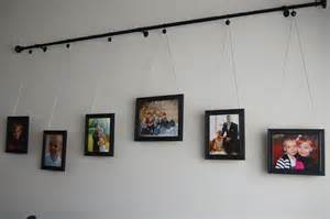 How To Do A Gallery Wall by Diy Curtain Rod Gallery Wall
