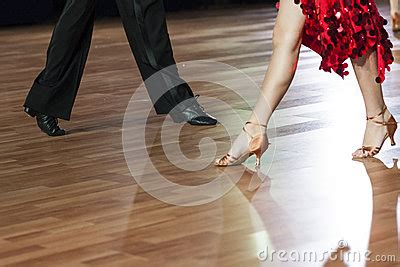 swing dance time signature closeup of legs of two professional dancers performing