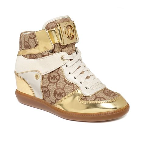 michael kors sneakers lyst michael kors nikko high top wedge sneakers in metallic