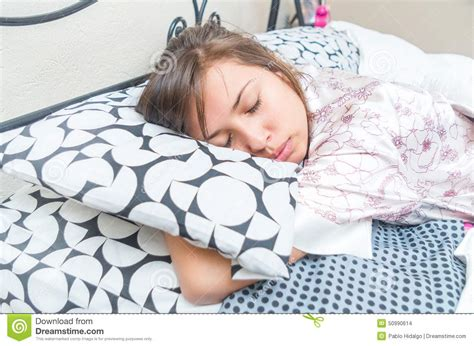 Cute Teenager Girls Sleeping Stock Photos And Images | cute young girl sleeping hugging pillow stock photo