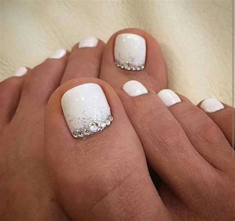 wedding toe nail art design white on white french pedicure picture of white nails with silver glitter and beads on