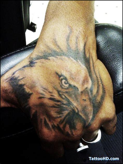 eagle tattoo in hand eagle head tattoo on left hand