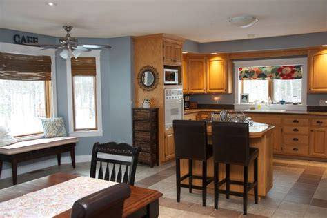 blue kitchen with oak cabinets oak kitchen with blue grey wall color kitchen reno is not in the cards right now so i had to