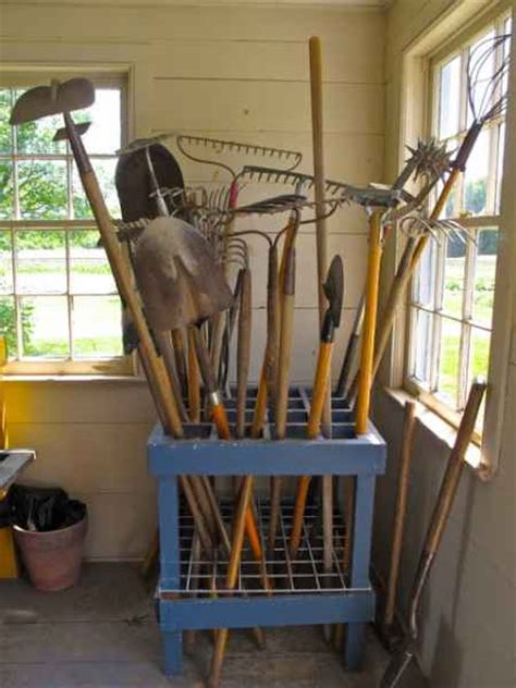 18 Creative Ways To Store Shovels, Rakes, And Vertical Gear