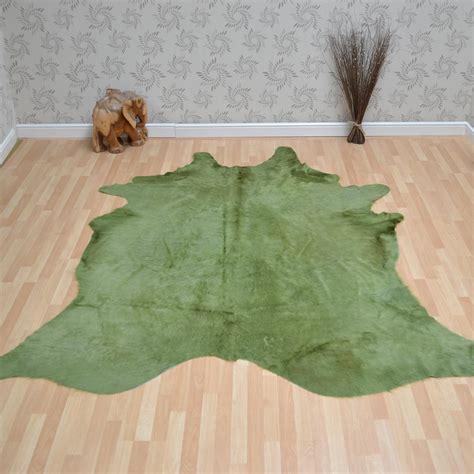 green cowhide rug cowhide rug in plain green free uk delivery the rug seller