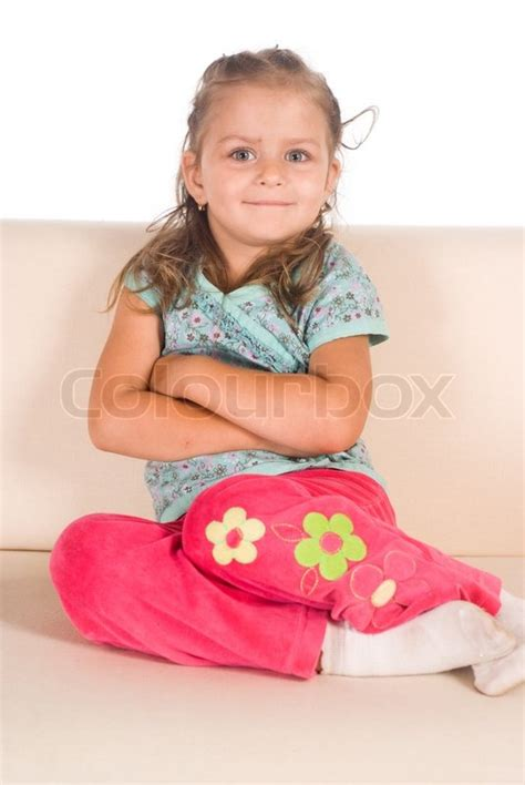 little girl couches little girl on sofa stock photo colourbox