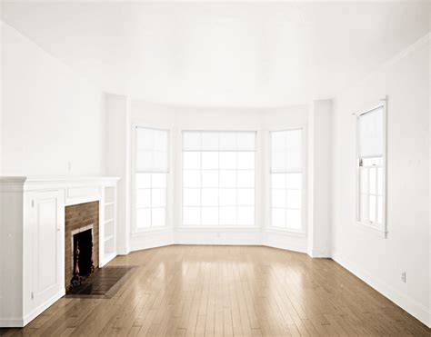 transparent window covering empty room light brown floor fireplace white by