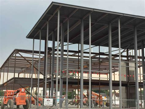 center for student life and college of business construction update structures coming down steel going