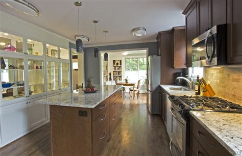 galley kitchen open to living room opening up a small 1940 s colonial braitman design studio