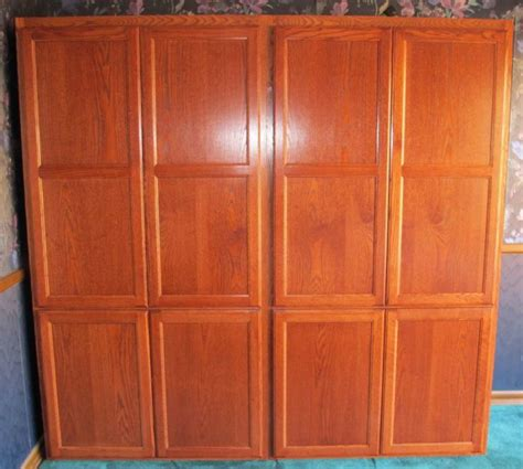 Eagle Cabinets by Oak Flat Panel Armoire Eagle Cabinets