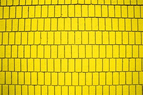 bright yellow wallpaper for walls bright yellow brick wall texture with vertical bricks
