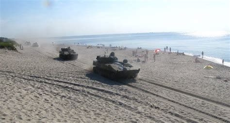 russian beach watching tanks racing through the beach is surprisingly