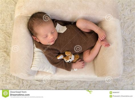 baby on couch newborn baby sleeping on soft couch stock photo image