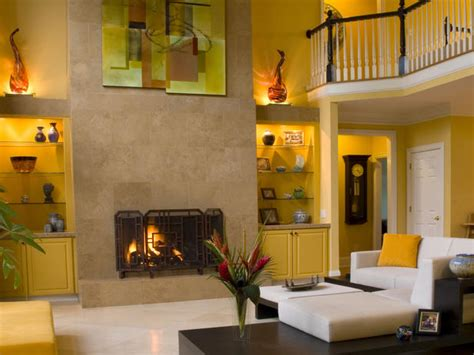 yellow fireplace yellow living room with travertine fireplace hgtv