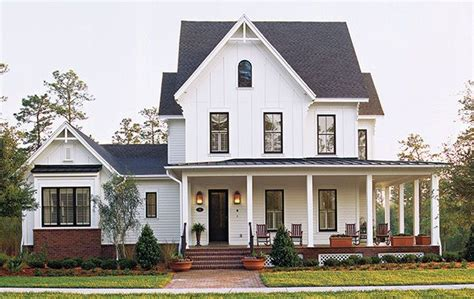 white house with black windows white house black window trim white white trim black