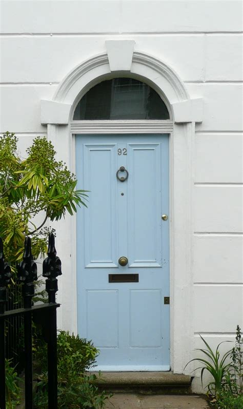 beautiful sky blue front door lovely colour   white walls doors  tables