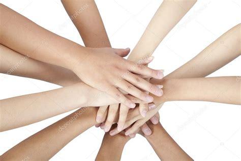 grupo de las manos juntas aisladas en blanco fotos