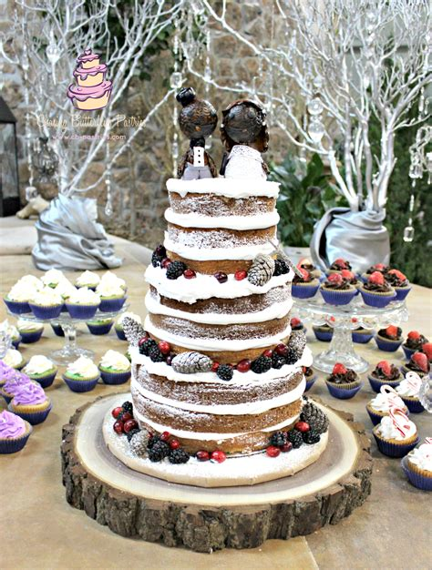 winter themed rustic wedding cake with handmade big planet cake toppers fashioned