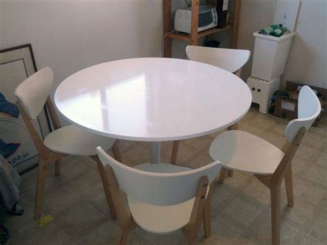 ikea docksta dining table with 4 nordmyra chairs fixed
