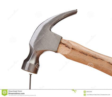 hitting a hammer hitting a nail royalty free stock photo image 38302485