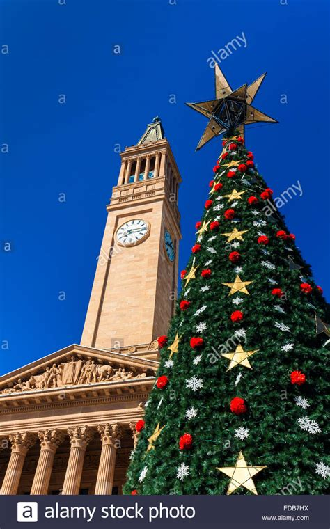brisbane city christmas tree and a city hall tower against