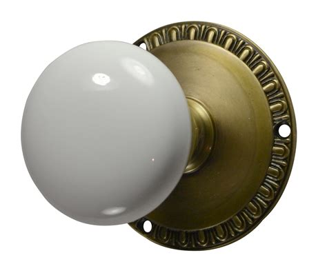 egg dart white porcelain door knob antique brass finish