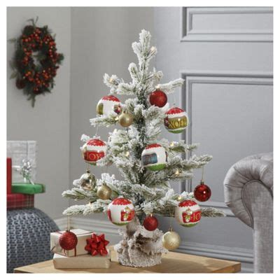 xmas trees frosted pull up buy dobbies pre lit bo frosted sapling tree 2ft from our trees range tesco