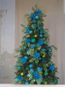 Christmas tree decorated in colors of the sea turquoise lime green