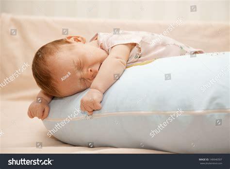 newborn baby laying on pillow on stock photo 148946507