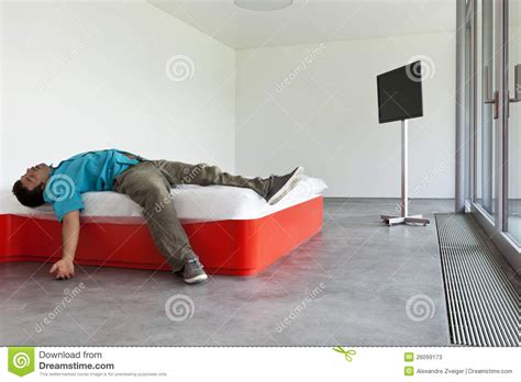 the bed guy guy lying on the bed stock photos image 26099173