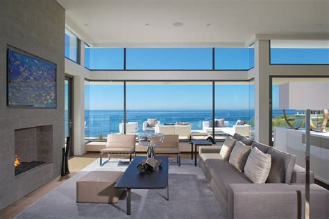 big window house sofa fireplace large windows beach house in laguna beach california