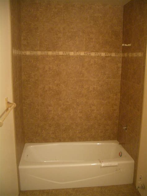 Ceramic Tile Bathroom Porcelain Tile Shower With Travertine Band