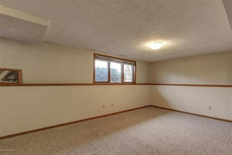 liking the half walls basement garage remodel ideas what to do with this ledge in the family room
