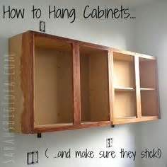hanging upper kitchen cabinets how to install cabinets like a pro the kitchen wall