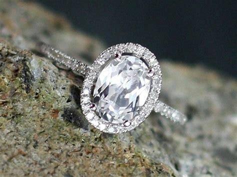 white sapphire engagement ring ovale diamonds oval