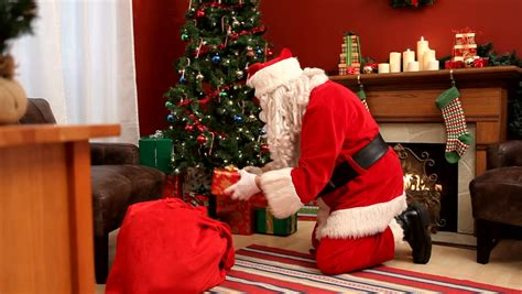 stock video  santa claus putting gifts  christmas