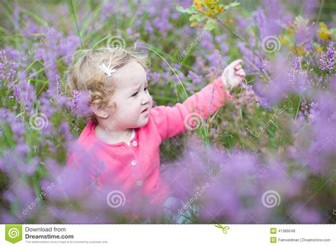 happy baby with beautiful purple flowers stock photo image 41386648