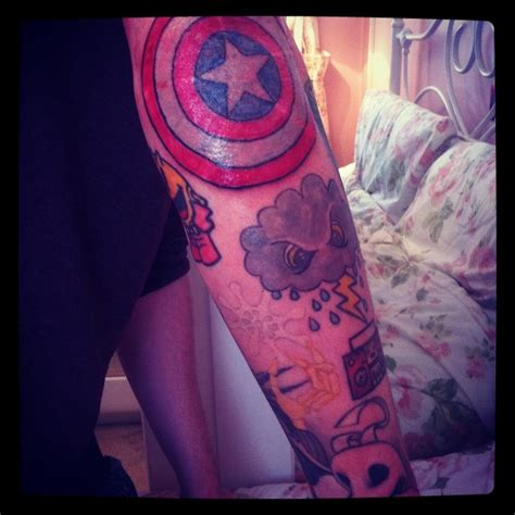 captain america shield on elbow tattoo inspirations