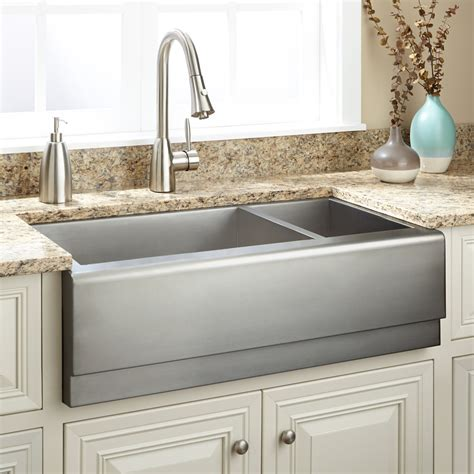pictures of farmhouse sinks 33 quot executive zero radius 70 30 offset double bowl