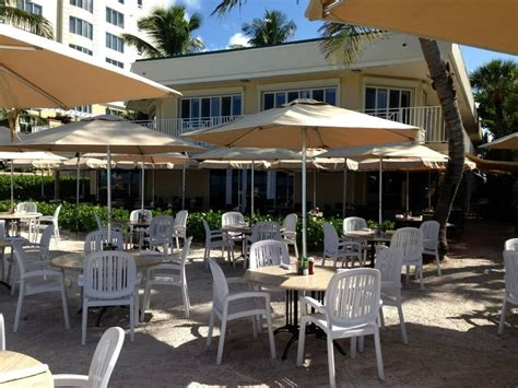 The Waterfront Dining Bar Patio by Turtle Club Dining On The Sand At Vanderbilt Resort
