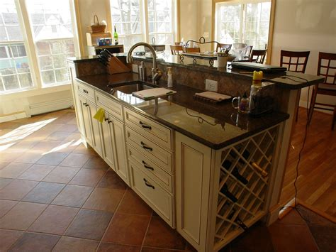 kitchen island with sink and raised bar k c r